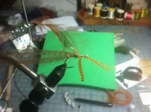 Fly Tying Step 6 - add 3 sili legs to underside of hook shank